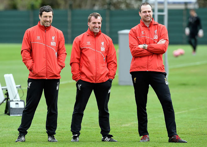 Brendan Rodgers manager of Liverpool and Glen Driscoll head of performance and Ryland Morgans head of fittness